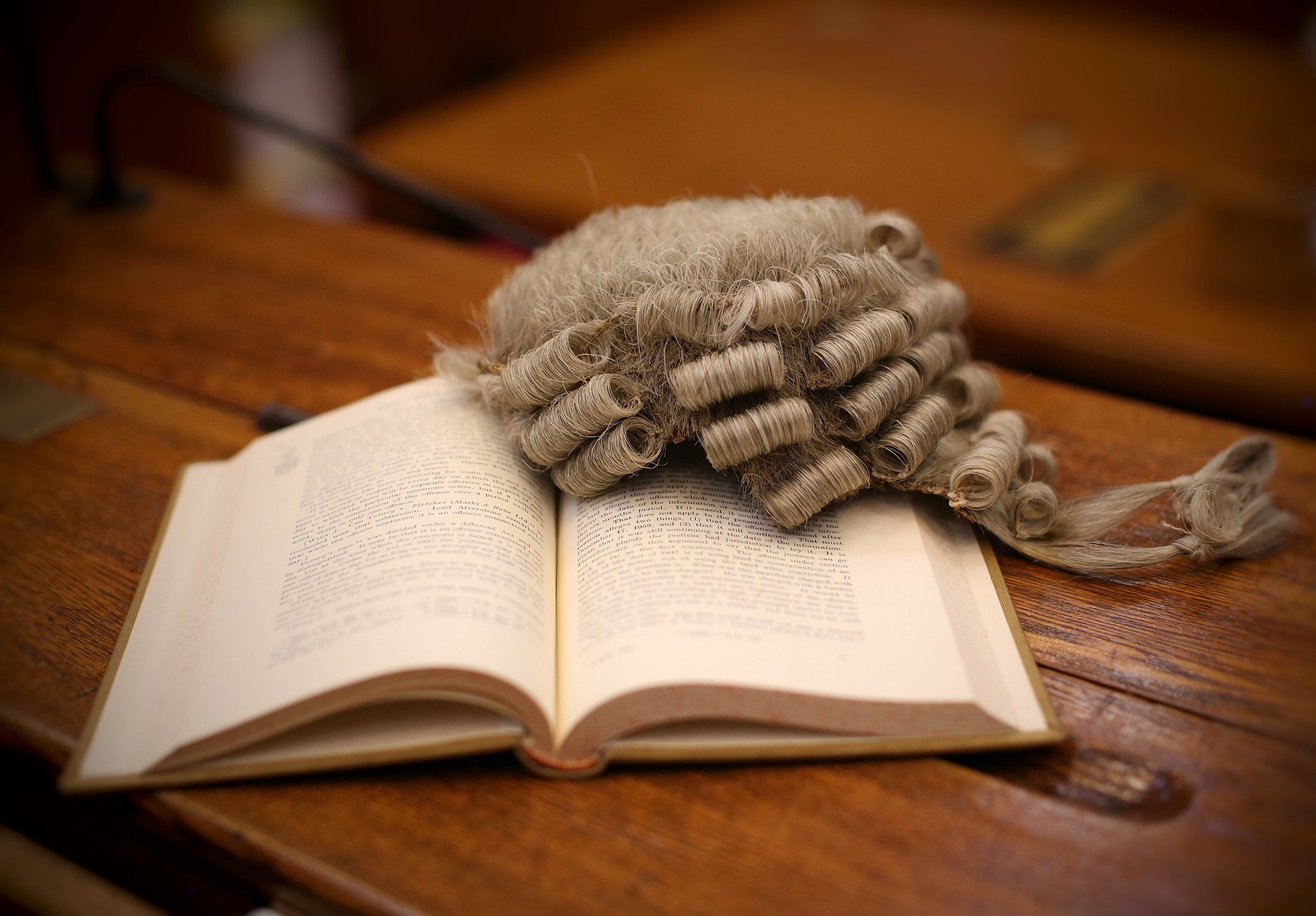 judge's wig and court text book
